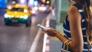 Woman Using a Ridesharing App to Prevent Drunk Driving