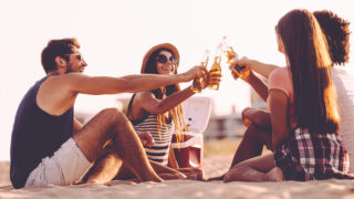 People on the Beach Drinking